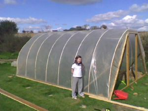 me with greenhouse under construction
