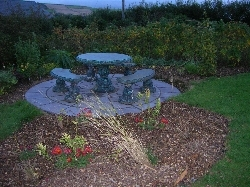 stone circle with surrounding beds mulched