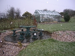 stone circle & greenhouse in snow