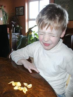 Josh eating the orange